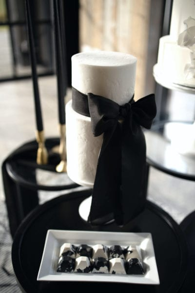 White cake with black ribbon