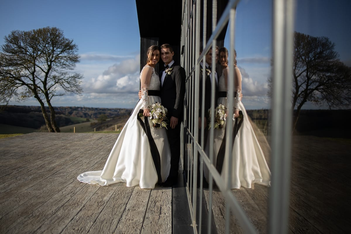 Wedding couple with reflection in window