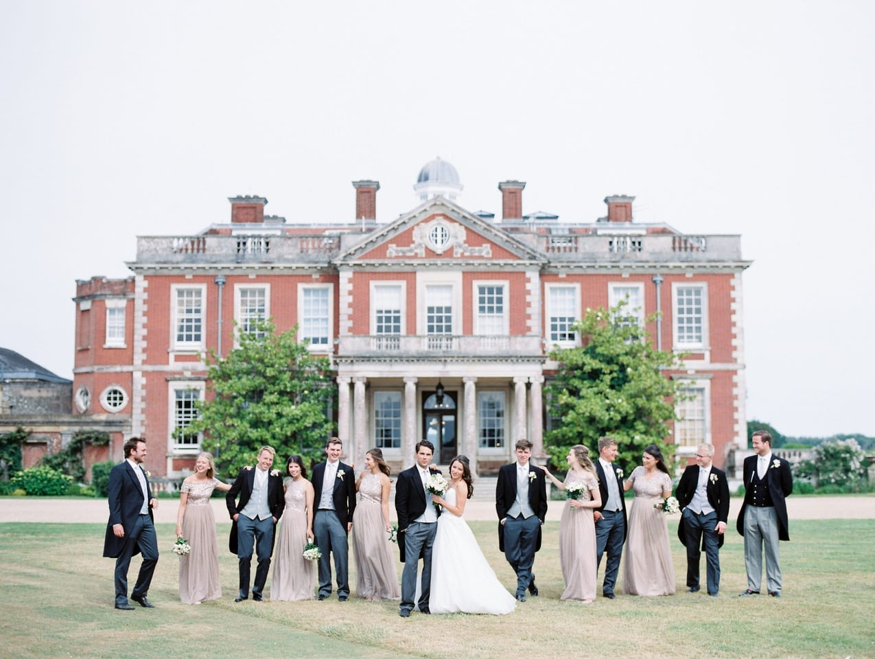 Group wedding photo in front of house