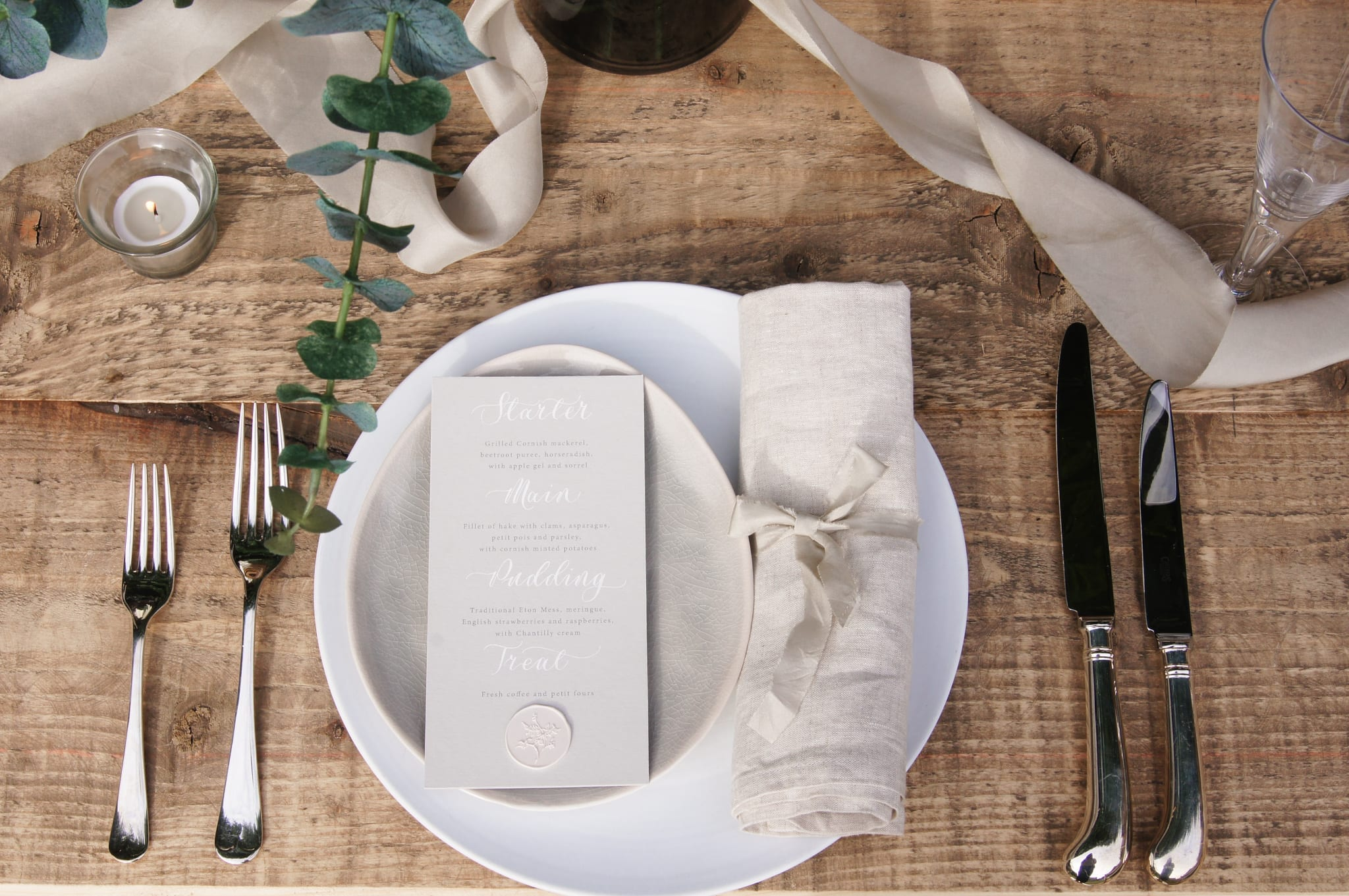 Tablescape with eucalyptus and silk ribbon