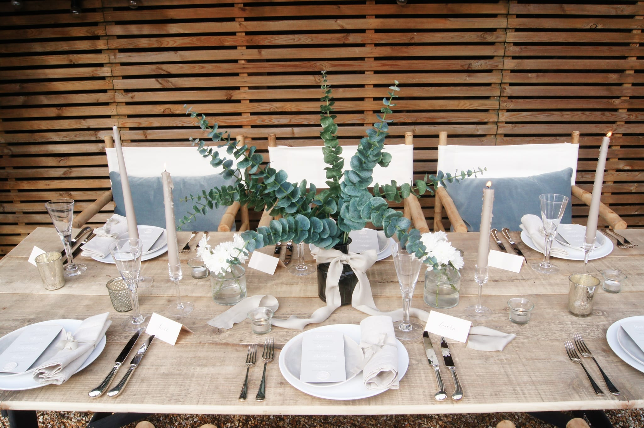 Table set up with eucalyptus and ribbons
