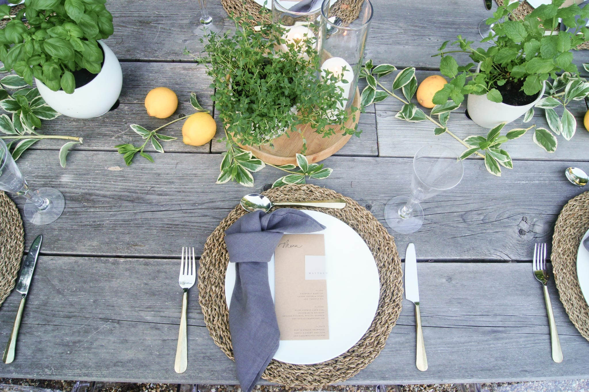 Table setting with herbs and grey napkin