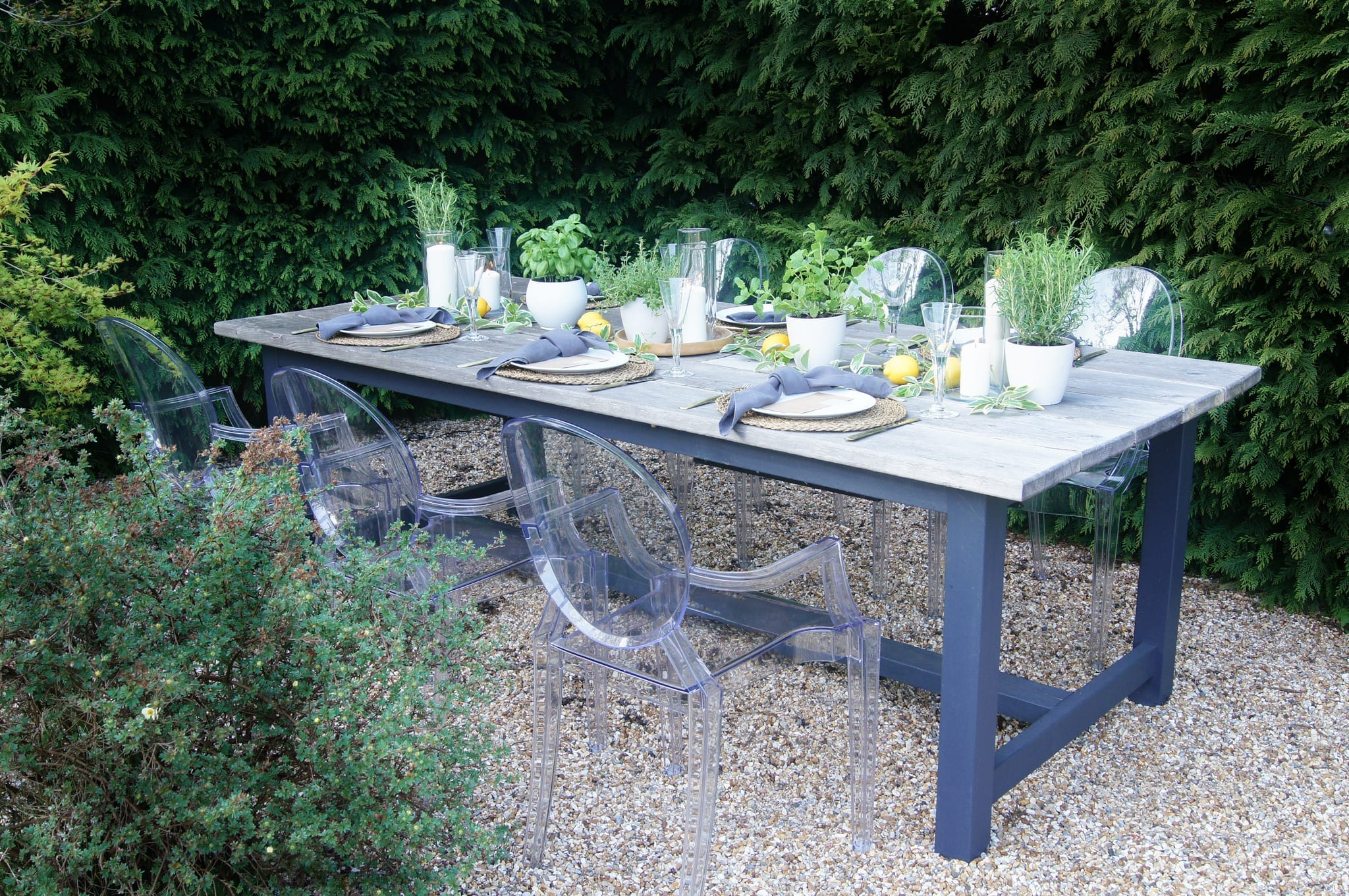 Garden table with ghost chairs
