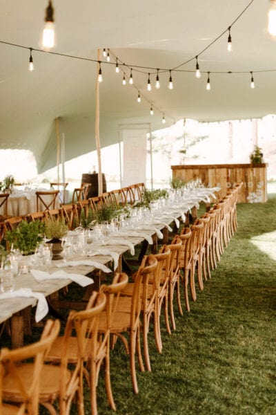 Tables beneath stretch tent for English country wedding
