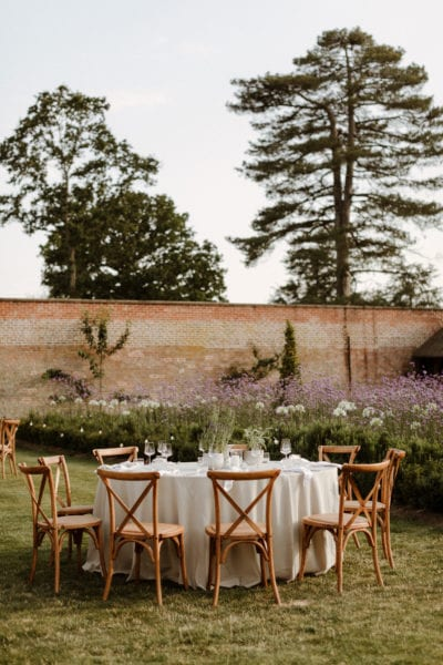 Table set up for relaxed welcome bbq at English country wedding