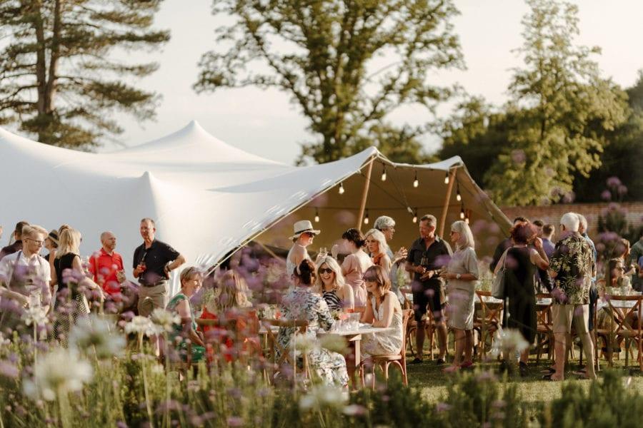 Guests enjoying bbq at English country wedding