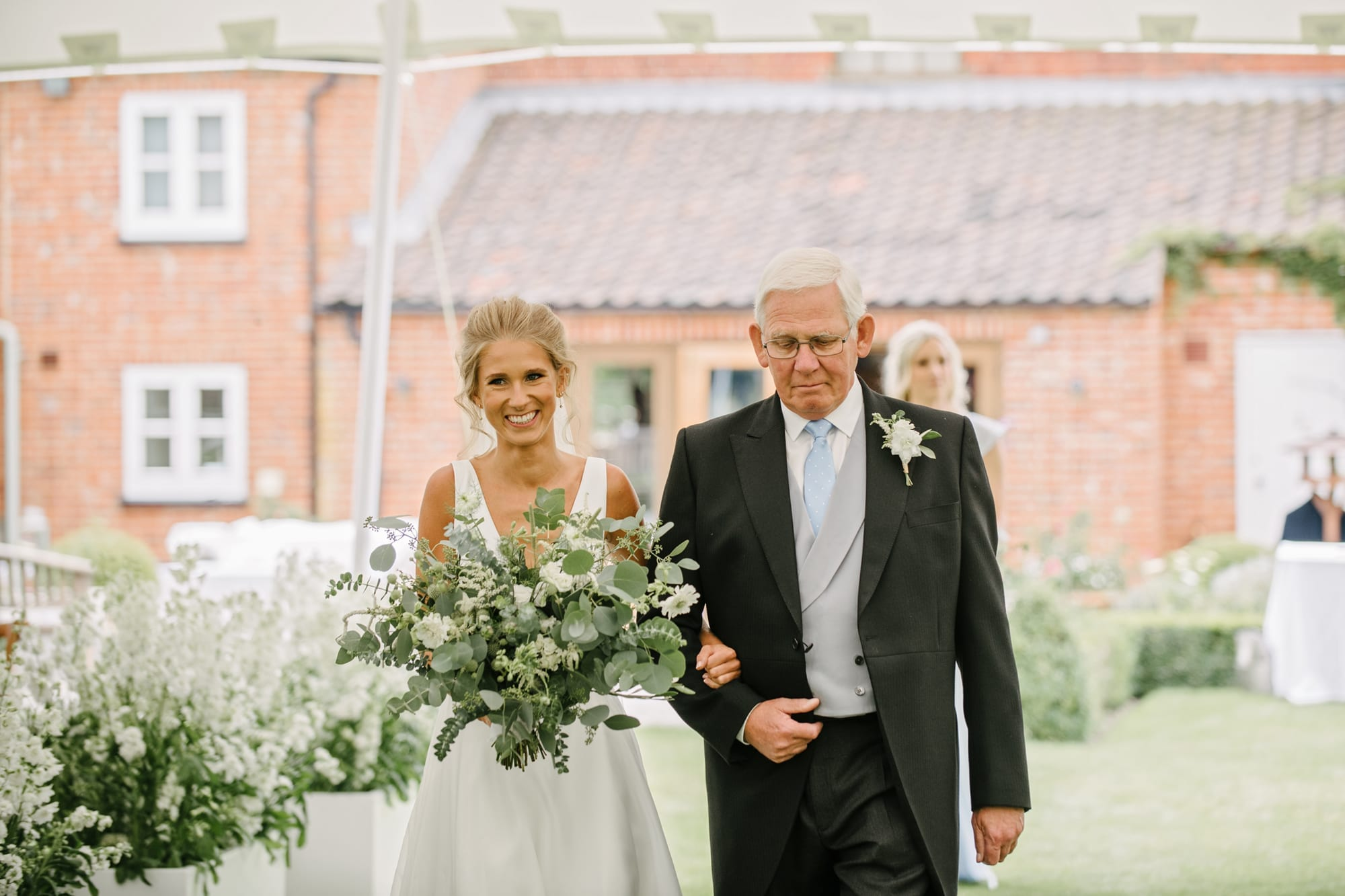 Bride with Father walking down the aisle for wedding ceremony