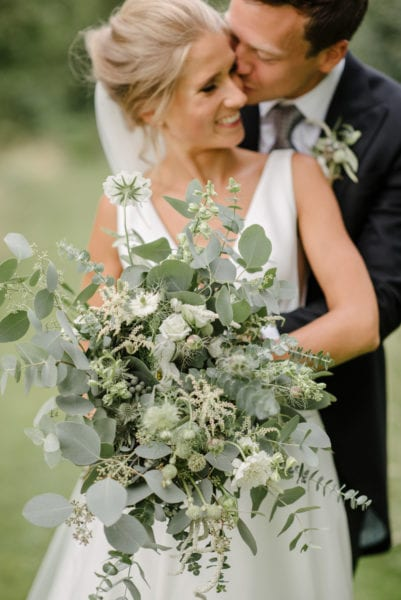 Bride with bouquet of green and white