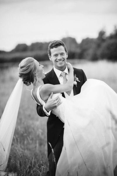 Black and white image of couple after their English garden wedding ceremony