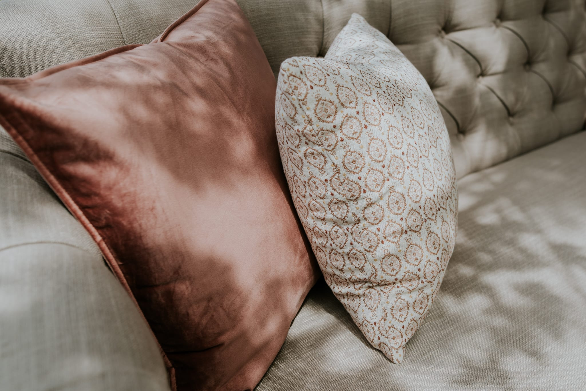 Selection of pink cushions for wedding lounge area