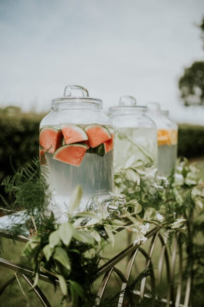 Fruit and herb infused water in glass drinks dispenser